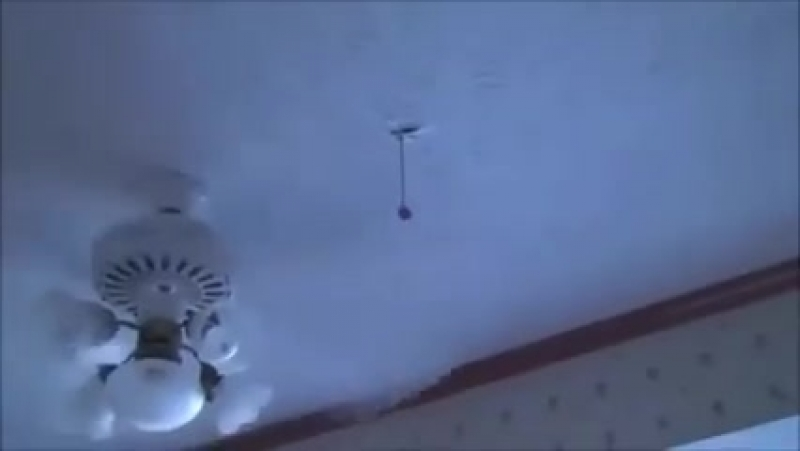 Man puts hand in spinning fan unharmed