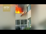 Raw footage Flaming firefighter jumps out of burning apartment