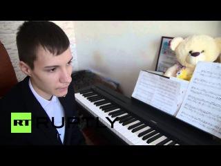 Россия: Пальцев пианиста показывает свои навыки в Казани.