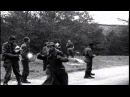 Liberated American POWs kick, hit and throw things at newly captured German Stock Footage