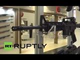 Германия: Сотни стекаются в безопасности торговой ярмарке как продажи оружия усилится.