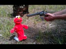 Elmo gets shot in the face and loses his head