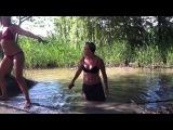 Girls having fun with the mud man at Hidden Beach Minneapolis
