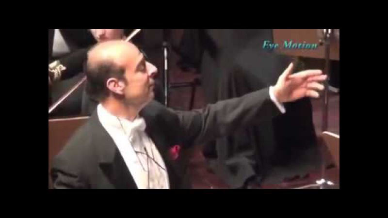 Crowd starts clapping mid-performance, so the maestro motions them to silence. Then he gets a better idea.