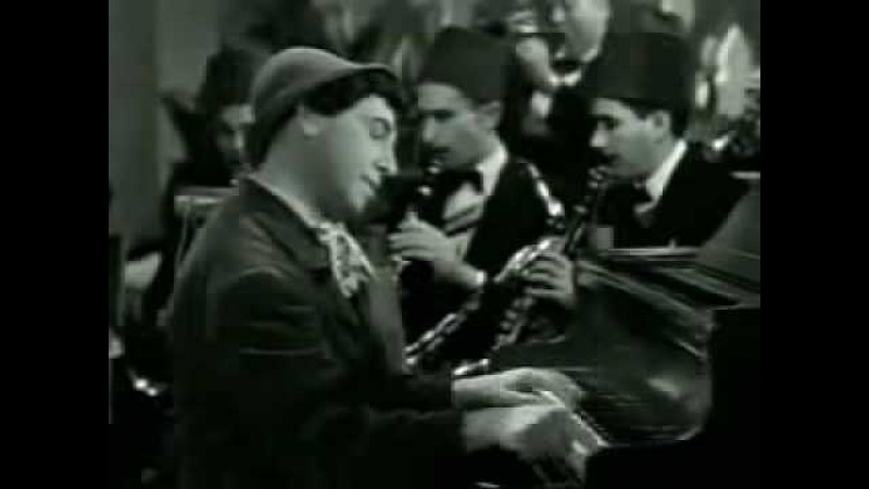 Chico Marx playing piano in