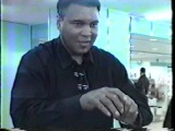 Muhammad Ali doing magic tricks in an airport for wrestlers