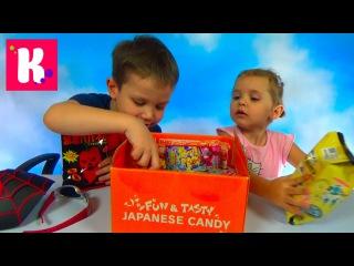 Мисс Кейти и Мистер Макс распаковывают посылку с японскими сладостями