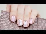 Нежно-розовый дизайн ногтей с заклепками