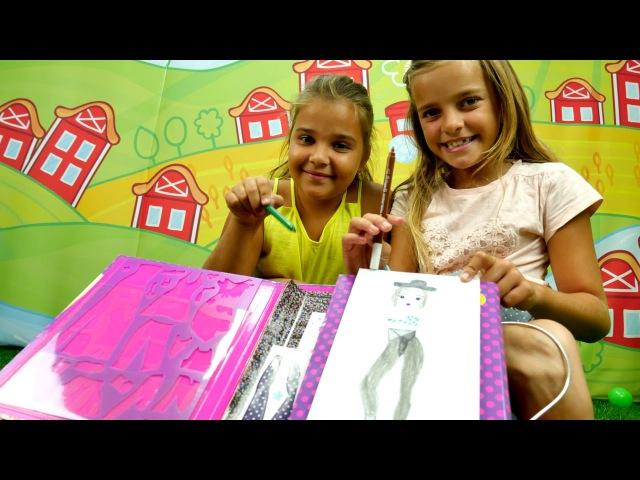 Sema oyuncak bebeklerini moda kıyafetleriyle çiziyor. Çocuk resim çizme. Kız oyunları