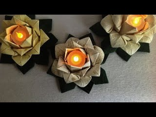 Origami lotus. Candle -Table decoration. 20 petal origami lotus with stamen. Ideas for Easter
