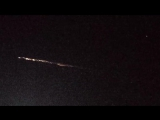 A Rocket Booster Falls Back to Earth