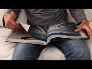 Free Footage. Man reading big book close up