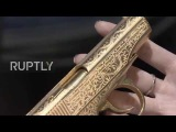 Russia The lady with the golden gun - check out Caviar's special edition Makarov pistol and iPhone