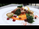 The art of plating and presentation of food - Duck, orange, berries, brussels sprouts, raisins, kale