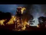 Первый рыцарь (1995). Нападение отряда Малагана на деревню