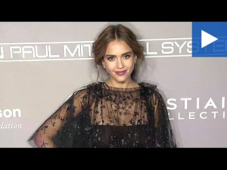 Jessica Alba stuns in a floral black dress at the Baby2Baby Gala