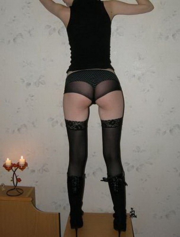 Sex wearing a leather skirt