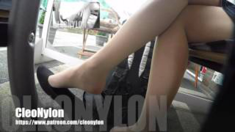 22 candid dangling shoeplay with flats in a cafe