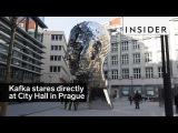 A sculpture of Franz Kafka's head faces City Hall in Prague