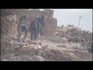 View .. Syrian army attack on the militants Daesh in cemeteries in the area of Deir al-Zour