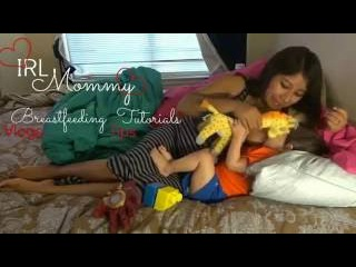 Breastfeeding On Demand   Laughing and baby playing with mommy's shirt