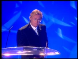 Help Album for War Child wins the Freddie Mercury Award presented by Roger Taylor. BRIT Awards 1996