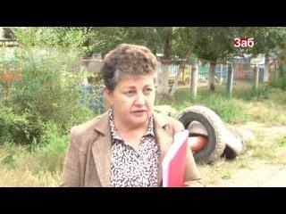 Жители дома на Угданской, 40 в Чите 12 лет ведут войну против незаконных гаражей
