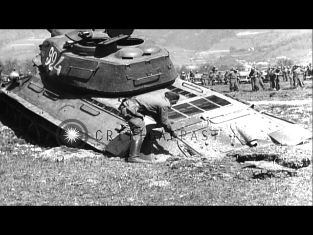 Soviet Army Lend-lease M-4 tank pulls Soviet tank out of mud hole in Liezen, Aust...HD Stock Footage