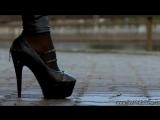 sexy girl walk in high heels and wetlook leggins