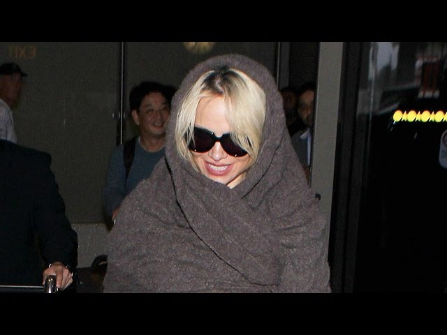 Pamela Anderson Covers Up After Doing Final Nude Playboy Shoot