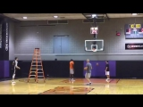 Dragan Bender uses the Planet Orange Ladder 7-foot Defender Challenge Simulation Device for shooting practice