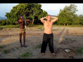 Traveling in a primitive and isolated African tribes Mursi and Hamar tribes rituals and ceremonies.