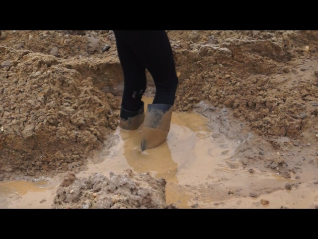 Girl flood riding boots in mud