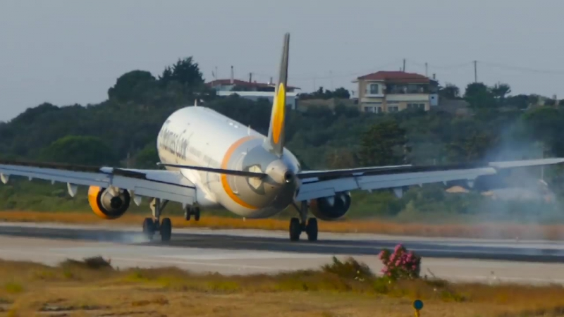 LOW flying BOEING and AIRBUS planes at SKIATHOS - Crossing the street at Skiathos Airport