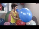 Girl blow to pop big blue balloon