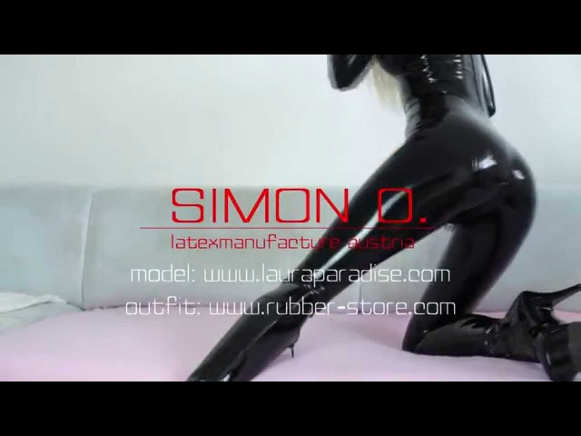 Laura wearing a skin tight latex catsuit