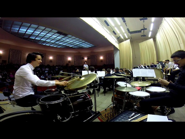 Concerto for drum sets and concert band by Larry Neeck