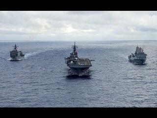 Два десантных корабля США против Адмирала Кузнецова