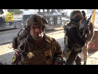 See how SPLA forces seized control of the Jerusalem neighborhood in Mosul, and how they were received by parents