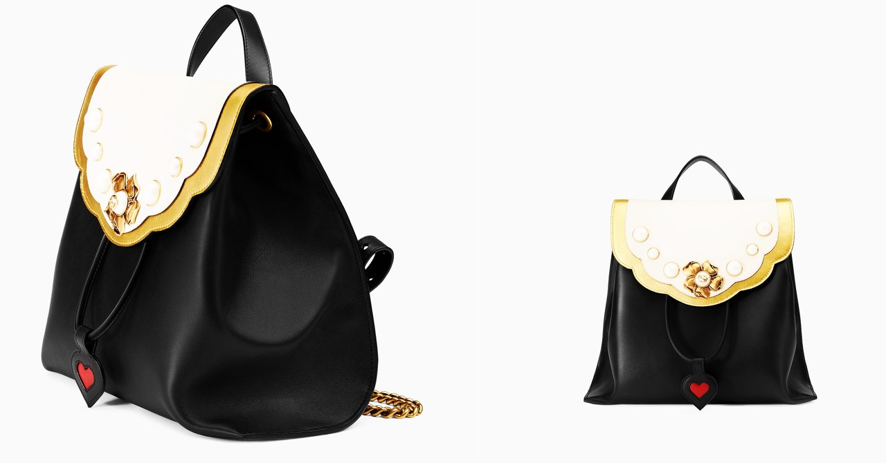 eed8d5ff4d8 You always know when it s Gucci  this studded with faux pearls and big  golden flower backpack will definitely make a statement and catch  everyone s eyes.