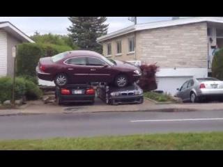 LiveLeak - Aftermath of car that went airborne landing on 2 parked BMWs