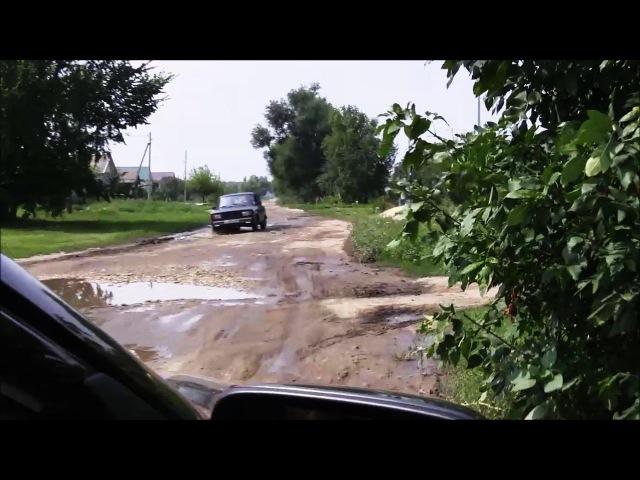 Убитая дорога на улице Чапаева в посёлке Самойловка