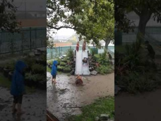 Children Play in Mud Puddles as Severe Weather Lashes New Zealand