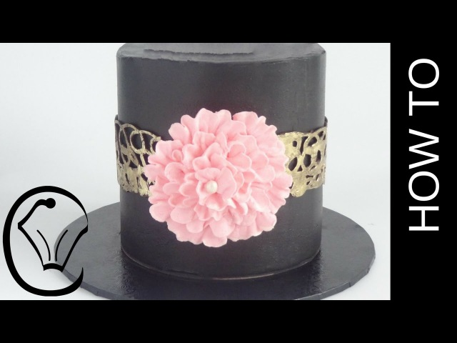 Black Chocolate Ganache Cake with Gold Chocolate Collar and Buttercream Flower