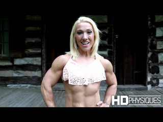 BIG MUSCLES on a female physique competitor