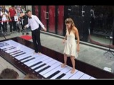 Couple plays The Pink Panther Song on Giant Piano With their Feet.