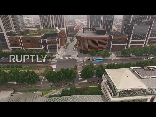 Китай: Искусство движения - «Бронзовый бамбуковый» фасад самых последних ориентиров Шанхая.
