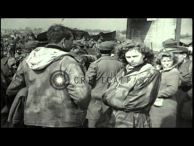 American soldiers rest after the battle at the Tangermunde bridge in Germany Stock Footage