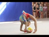 Rhythmic gymnastics performance with the ball. Children's competition in rhythmic gymnastics