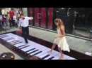 A Couple Play Music Pink Panther Movie By Foot On the Street
